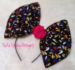 Over-sized Black Hair Bow with multicolored drops on it.